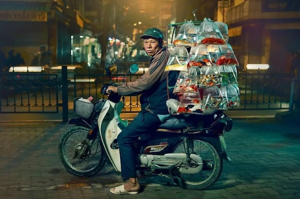 Photographer Captures Moped Delivery Drivers In Hanoi