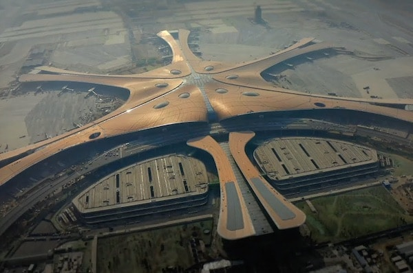 Zaha Hadid Architects' Giant Starfish-Shaped Airport Opens In Beijing