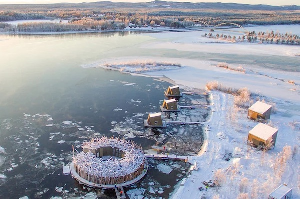 Sweden's Floating, Circular 'Arctic Bath' Hotel Opens On The Lule River