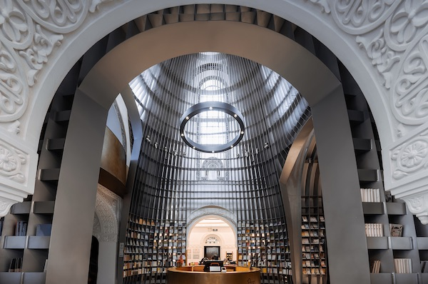 Corrugated Steel Shelves Line A Church-Turned-Poetry-Shop In Shanghai
